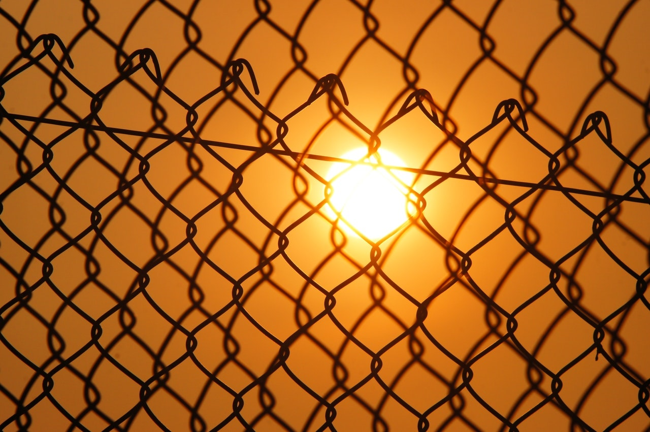 Sunset through chainlink fence - Sermon on the Mount Part 8, why does Jesus bless the merciful?