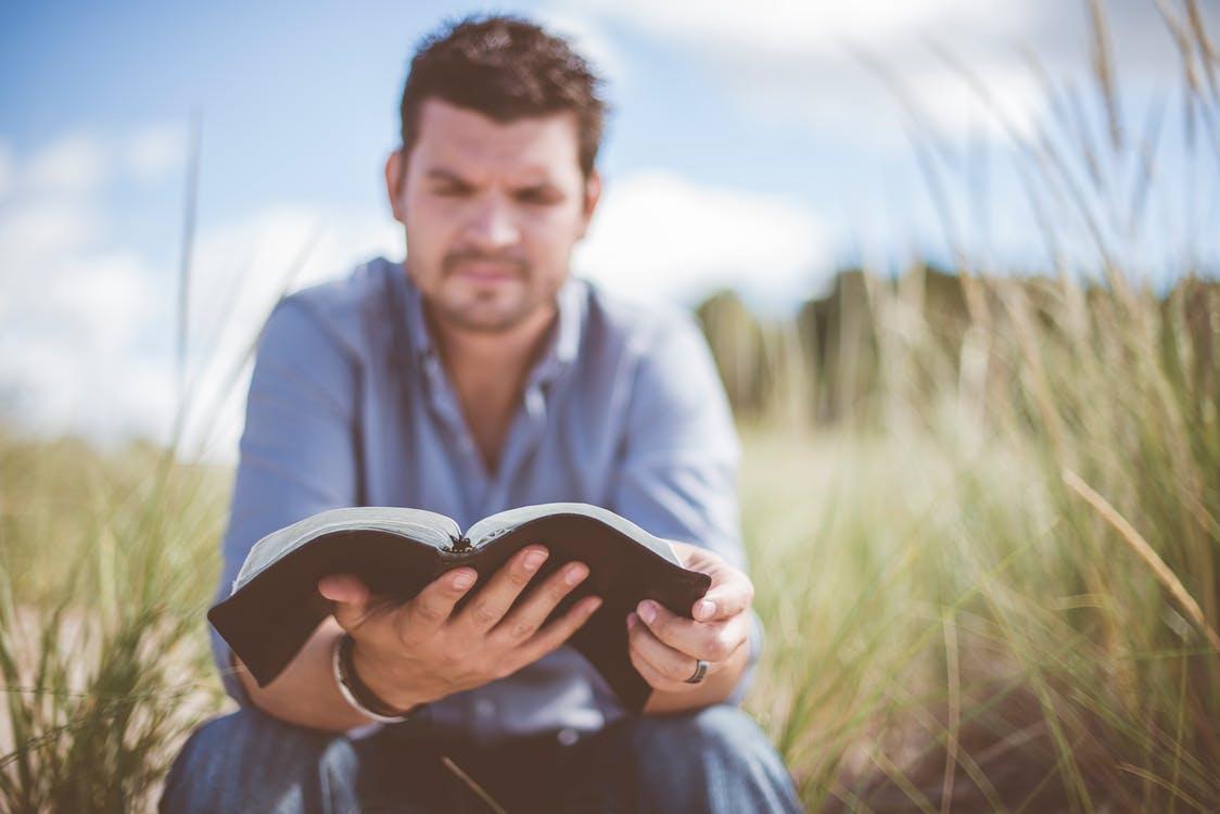 Man reading Bible Galatians